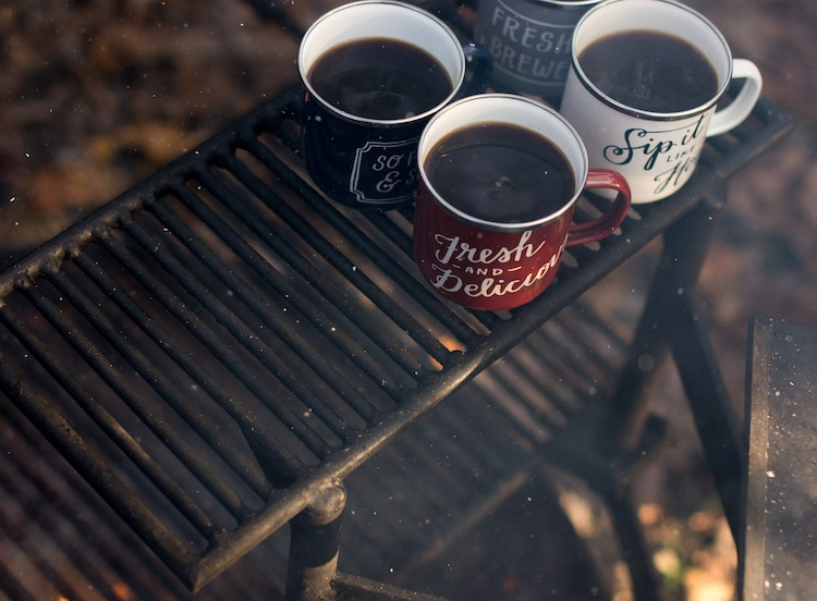 camping cups on grill